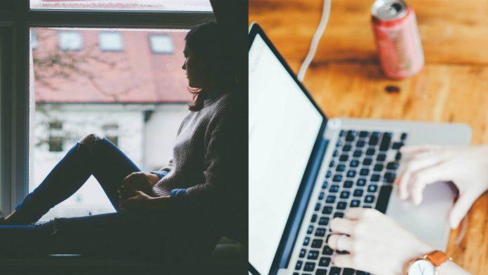 En kvinna sitter i ett fönster och tittar ut. Någon använder en bärbar dator.