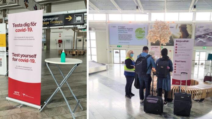 informationstavla med handsprit och en familj som anlänt med flyg som får information om provtagning.